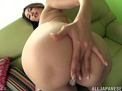 Take a look at Asami Ogawa's amazing ass and her camel toe before she takes off her panties and masturbates with a dildo.