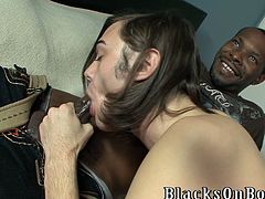 Devon Michaels gives a skillful blowjob to a Black dude. After that this White guy lies down on a bed and gets butt fucked from behind.