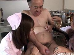 Two gorgeous long-haired Japanese bitches wearing nurse uniforms are having fun with some old man indoors. The girls put their thongs on the man's face and drive him crazy with a handjob.