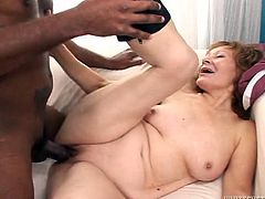 Madly horny granny takes parts in hardcore gangbang porn scene. She sucks BBC while getting hammered bad from behind. She also gets fucked missionary style.