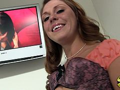 Brown-haired milf Scarlett Wild is giving an interview after they shoot the sex scene. She shows her small flabby tits and rubs them.