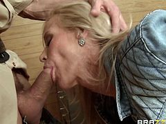 This blonde slut heads over to the country sheriff's office, to report a robbery, but she get a lot more, than she bargained for. The cops all gang up on her and fuck her, like crazy. She puts her tits up, against the one way mirror and gets drilled with a billy club. Watch her suck cock.