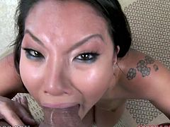 Narrow eyed porn star Asa Akira gets massive mouth cumshot