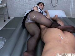 Check out this hardcore scene where these Asian babe's fucked by this guy after she's oiled up and he rips her pantyhose.