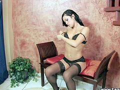 Press play to watch this brunette babe, with born breasts wearing nylon stockings, while she masturbates sitting on a chair until she has an orgasm.