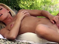She looks fantastic with her pink vag exposed in sensual outdoor solo