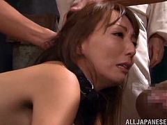 This young sex slave gets hard fucked from behind and, at the same time, she had her lips on a cock. She is getting it from both ends. The cruel mistress watches the sex and then, grabs the slut by the hair, and tells her to do a job better.
