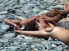 For this horny voyeur seeing nude girls at the beach is quite stimulating