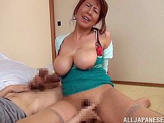 Mature Saya Niiyama gets her big boobs and vagina licked. This naughty woman strokes a dick while a guy fingers her pussy.