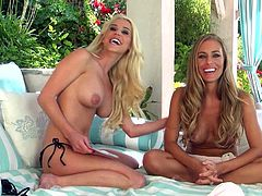 Nicole Aniston and Spencer Scott pose for a camera in a veranda. These beauties take off bikini bras to demonstrate their hot boobs.
