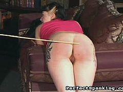 Ass slashing with Mistress Gemini. She takes two hotties into her dungeon for a spanking torture session. Loads of hot juice and paddling, and the stinging pain of the cane lash.
