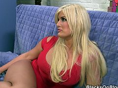 Curvy blonde milf Julie Cash drives a black stud crazy with a blowjob. Then she stands on all fours and lets the guy drill her pussy doggy style.