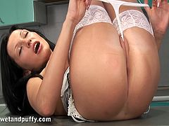 Share this with your friends! A brunette chick, with a nice ass wearing sexy stockings, while she touches herself and plays with a big toy.