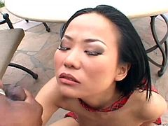 A petite Asian girl plays with her shaved pussy outdoors. Then Niya gets banged by a brutal Black dude on a table in a backyard.