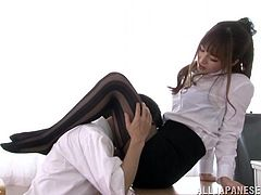 Hot Japanese teacher Misa Yuki wearing pantyhose is having fun with some dude indoors. She massages the dude's boner with her feet and enjoys it much.