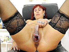 Darja dragged her fat ass to the doc, for a pussy exam. She took a seat on the gynecologist chair, spread her thighs and allowed the doc to check out her cunt. The doc gaped her pussy, examined it and then, inserted a plastic speculum deep in it. Look at the inside of her pussy, if she's gonna get some semen in it