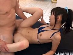 Slutty Minami Hirahara blows two cocks sitting on a floor. This Asian girl gets fucked in her mouth and tight pussy at the same time in a threesome sex video.