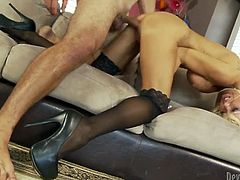 Busty blond MILF gets fucked in sideways and doggy styles by her horny student