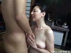 Have a blast watching a Japanese MILF, with natural boobs and a hairy pussy, while she gets banged hard on the floor and moans loudly.