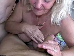 The two old fatties both have massive tits that hang over and bounce when they suck this guy's cock. They also suck on each others nipples when they don't have cock in their mouths.