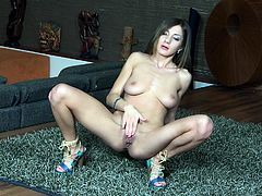 Captivating long-haired brunette Alice Romain is having some nice time in the living room. She demonstrates her perfect body for the camera and then sits down on the floor and masturbates her vagina.