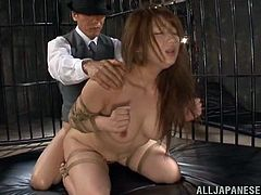Make sure you get a load of this hardcore BDSM scene where the busty Asian babe Shiori Kamisak is tied up before she's forced to suck on this guy's cock until she's fucked.