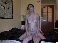 This shameless whore feels comfortable having sex in front of the camera. She rides her lover's stiff cock reverse cowgirl style.