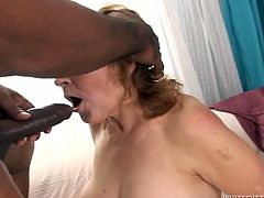 Although she is an old lady she still loves to fuck. She gets her pussy filled with huge black cock but she has two more cocks to handle. This whore is addicted to dark meat.