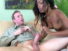 Cum thirsty black babe blows big cock like greedy. She sends big white cock deep in her throat and rolls her eyes with pleasure.