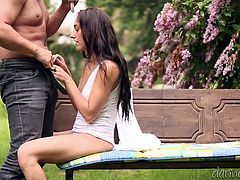 Check out this hardcore outdoors scene where this beautiful teen brunette is fucked by this guy on a park bench while he holds an umbrella so they won't get wet.