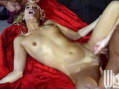 Take a look at this hardcore scene where the slutty blonde Debi Diamond is fucked by two guys in a threesome that leaves her out of breath.