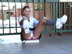 Cute blonde Alison Angel wearing college uniform is having fun outdoors. She has fun in the street, then flashes her tits and butt and sits down on the ground to have rest.