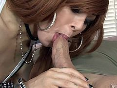 Red haired TS bitch gives her customer nice deep throat