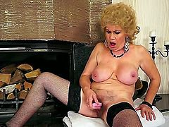 Busty Effie is a needy Grandma. She hasnt got anyone around to fill her needs and she is feeling horny. This doesnt stop her, she pulls out a mega dildo and stuffs her itchy pussy full of it.