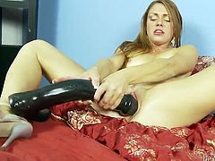 Nasty and perverted chick likes playing with big sex toys. She takes her unbelievably huge black dildo and masturbates her soaking cooch.