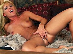 Pretty blonde Niki Young is having a good time together. She plays with her nice natural tits and then spreads her legs wide open and favours herself with masturbation.
