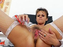 All alone in the cabinet, mature nurse thinks of deep stroking her hairy twat with a stiff toy