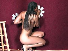 Lewd black chick Aryana Starr proves that she is a real bitch. She sucks and rubs a cock sticking out of gloryhole and then welcomes it in her sweet cunt.