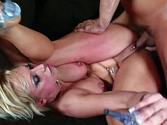 Insatiable blonde mom Nikki Hunter kneels in front of a man and lets him face-fuck her. Then they have anal sex in the reverse cowgirl position and Nikki nearly swoons with pleasure.