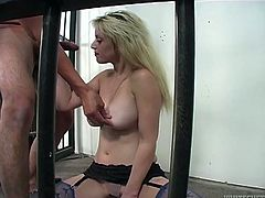This hot and zealous blondie in sexy lacy stockings knows how to suck cocks. She stands on her knees and gives her man a perfect blowjob.