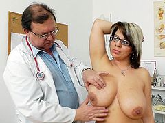 Gyno exam gets her pretty horny and in need for the doc to play a bit with her shaved fanny