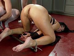 Three lesbian beauties gathered in the kitchen not to cook, but to fuck. See them in action on the cold floor. Their dirty game involves playing with a vibrator and an electric wand. The camera catches clear closeups of these sex toys inserted in the brunette's wet pussy and asshole.