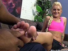 Masturbate watching this blonde babe, with a nice ass wearing shorts, while she masturbates a black dude until he cums on the floor.