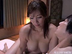 Look at this sexy bitch. Her man's shoves his cock deep into her mouth and thrusts nice and hard. He plays with her wet pussy and fingers her fast and furious. The sexy mature Asian slut moans as she is played with.