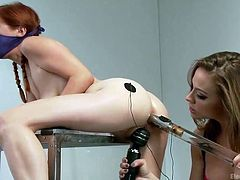 Welcome to the playground! Bondage and domination are allowed. Two lesbians enjoy playing dirty with a vibrator and an electric wand. The dominant bitch has handcuffed her companion and also covered her face. See the slutty girl with pigtails obediently bending on the desk and spreading widely her legs