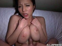 Busty Japanese mom Ruri Saijo wearing a bikini lets some dude oil her breath-taking big natural tits and play with them. Then she massages the dude's schlong with her jugs and they fuck in cowgirl position.