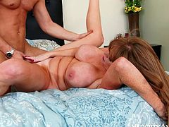 If your neighbor catches you jerking off, better hope she's as sexy as Darla Crane. This woman is the full package. She is hot and she has a never ending sex drive. Cock crazed mature slut rides this young stud's cock in cowgirl position. The way her big ass bounces up and down guarantees his dick won't go limp.