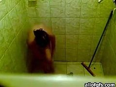 Dark haired horny bitch with nice body shows her ass taking the shower. Have a look at this slut in The Indian Porn sex clip.