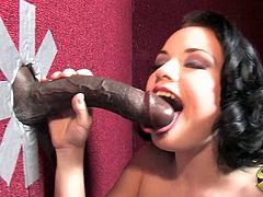 Have fun watching this brunette cougar, with a nice ass wearing nylon stockings, while she goes hardcore with a dark meat stick in a gloryhole.