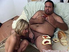 Take a nice look at this blonde babe, with a nice ass and a shaved cunt, while she gets fucked by a dirty fat guy surrounded by food.